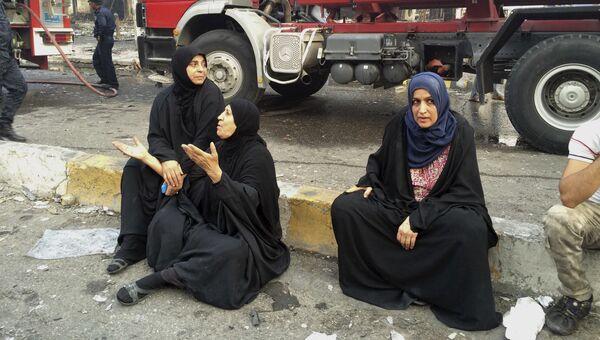 Женщины на месте террористического акта в Багдаде. 3 июля 2016