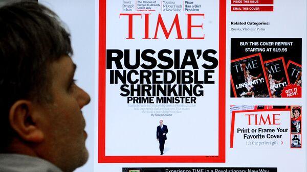 Обложка журнала Time на экране монитора