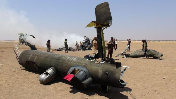 Обломки российского вертолета Ми-8, который был сбит в провинции Идлиб на севере Сирии. Архивное фото