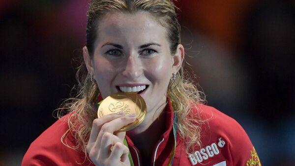 Инна Дериглазова, завоевавшая золотую медаль в соревнованиях по фехтованию на рапирах  на XXXI летних Олимпийских играх