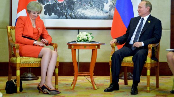 Президент РФ Владимир Путин и премьер-министр Великобритании Тереза Мэй. Архивное фото