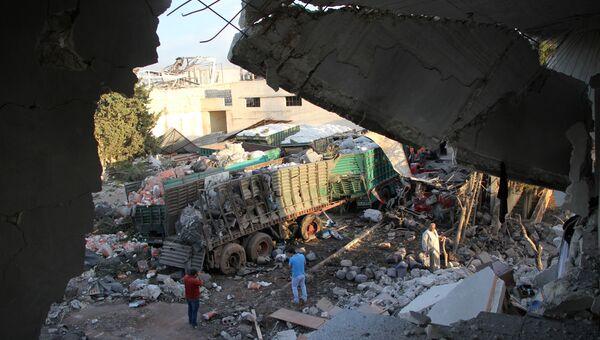 Грузовики гумконвоя ООН, обстрелянные в городе Урум аль-Кубра недалеко от Алеппо