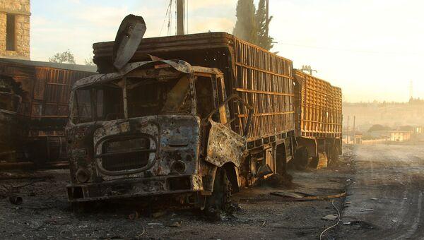 На месте обстрела гуманитарного конвоя ООН в городе Урум аль-Кубра недалеко от Алеппо. 20 сентября 2016
