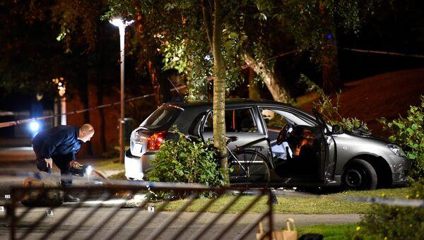 Полицейский осматривает место происшествия в городе Мальме. 25 сентября 2016