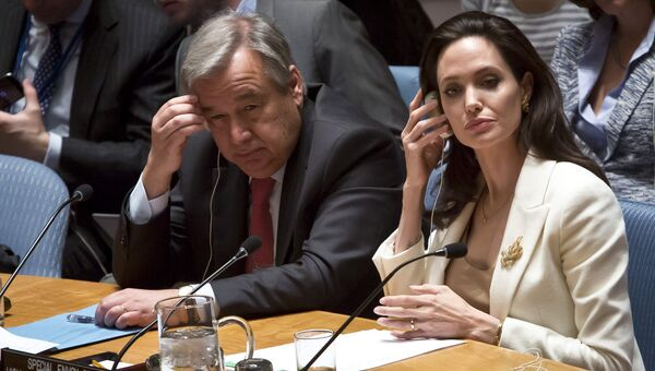 Посол доброй воли ООН Анджелина Джоли и португальский политик Антониу Гутерреш