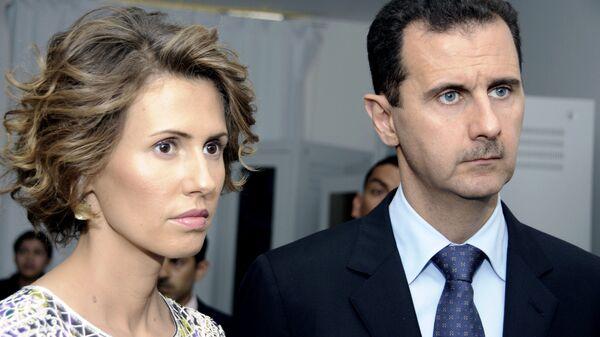 Президент Сирии Башар Асад с супругой Асмой Асад. Архивное фото