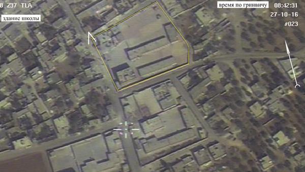 Фотография с российского беспилотного летательного аппарата в населенном пункте Хасс в сирийской провинции Идлиб
