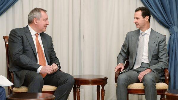 Заместитель председателя правительства РФ Дмитрий Рогозин и президент Сирии Башар Асад во время встречи в Дамаске