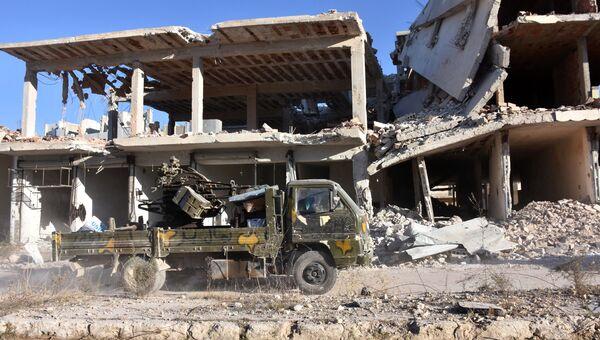 Военный автомобиль сирийской армии в восточной части Алеппо
