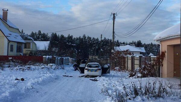 Место перестрелки сотрудников Государственной службы охраны и спецподразделения КОРД в поселке неподалеку от Киева