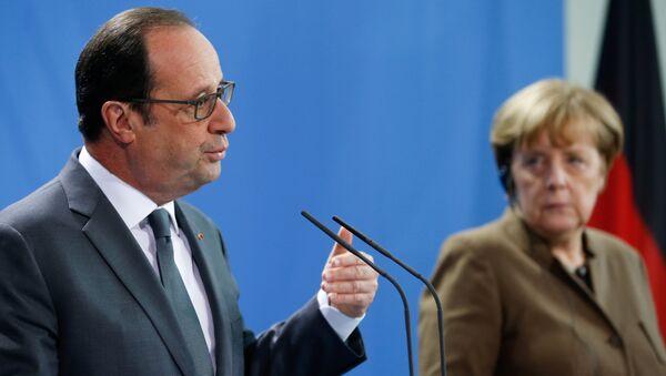 Президент Франции Франсуа Олланд и канцлер Германии Ангела Меркель на совместной пресс-конференции в Берлине. 13 декабря 2016