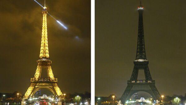 Огни Эйфелевой башни погасли ночью в знак поддержки пострадавшим в теракте в Квебеке. 30 января 2017 год
