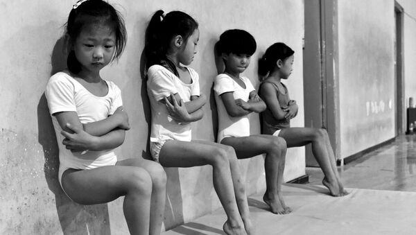 Sweat Makes Champions фотографа Tiejun Wang занявшего второе место в номинации Повседневная жизнь в фотоконкурсе World Press Photo