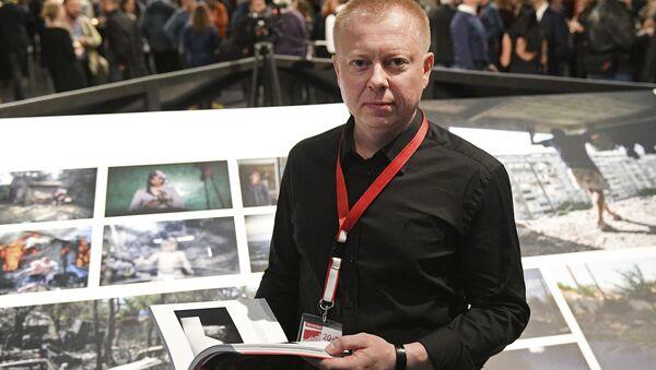 Специальный фотокорреспондент МИА Россия сегодня Валерий Мельников на открытии выставки победителей World Press Photo в Амстердаме