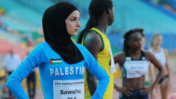 Спортсменка в хиджабе