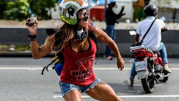 Участница протестов в Венесуэле. Архивное фото