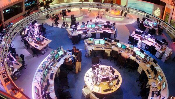 Сотрудники в офисе телекомпании Al Jazeera в Дохе, Катар. Архивное фото