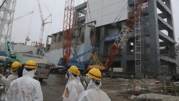 Работы по ликвидации последствий аварии на АЭС Фукусима-1 в Окуме, Япония. 12 июня 2013