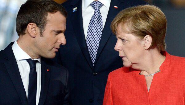 Президент Франции Эммануэль Макрон и федеральный канцлер ФРГ Ангела Меркель. Архивное фото