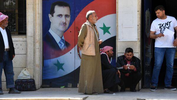 Портрет Башара Асада в Камышлы