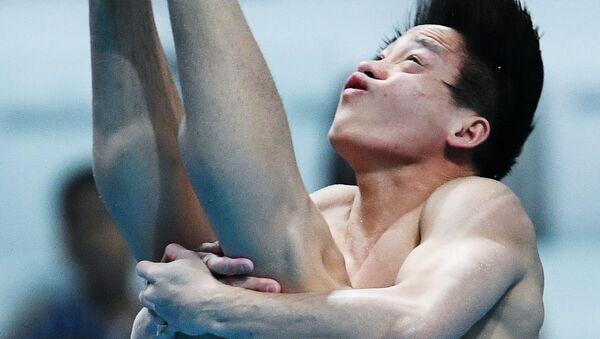 Чао Хэ (КНР) в финальных соревнованиях по прыжкам в воду с трамплина 1 м среди мужчин на чемпионате мира FINA 2017