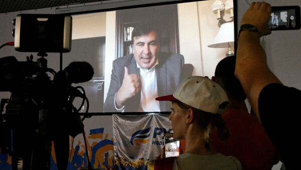 Видеотрансляция выступления Михаила Саакашвили из США в киевском офисе его политической партии. Архивное фото