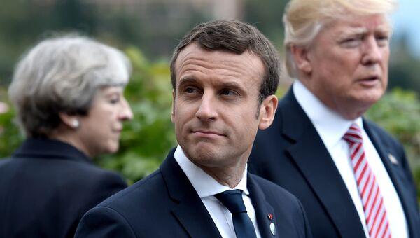 Премьер-министр Великобритании Тереза Мэй, президент Франции Эммануэль Макрон и президент США Дональд Трамп