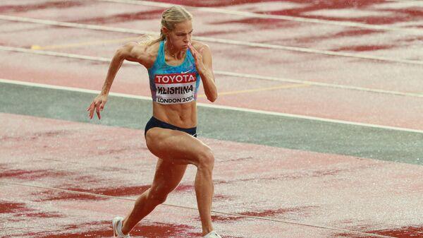 Дарья Клишина (АNA) во время квалификационных соревнований по прыжкам в длину среди женщин на чемпионате мира 2017 по легкой атлетике в Лондоне