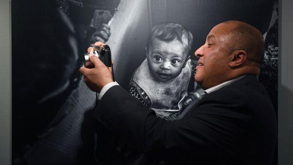 На выставке работ финалистов Международного конкурса фотожурналистики имени Андрея Стенина в Центре фотографии имени братьев Люмьер в Москве