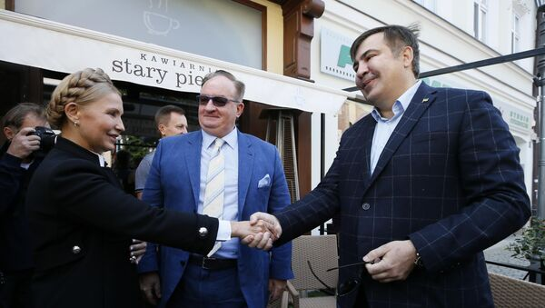 Михаил Саакашвили во время встречи с Юлией Тимошенко. 10 сентября 2017