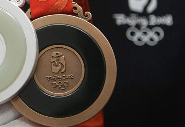 Бронзовая Олимпийская медаль
