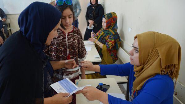 Жители на избирательном участке в городе Эрбиль во время референдума о независимости Иракского Курдистана. 25 сентября 2017