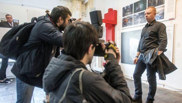 Победитель 2017 года в номинации Долгосрочный проект, фотокорреспондент МИА Россия сегодня Валерий Мельников на открытии выставки World Press Photo в Санкт-Петербурге