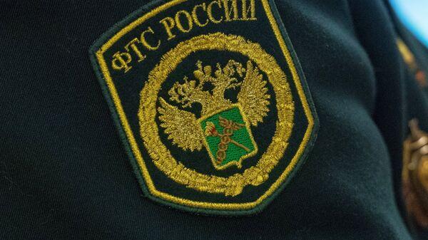 Шеврон на форме сотрудника Федеральной таможенной службы России