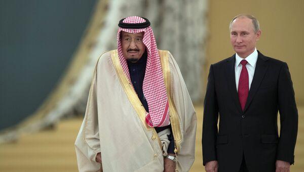 Президент РФ Владимир Путин и король Саудовской Аравии Сальман Бен Абдель Азиз Аль Сауд. Архивное фото