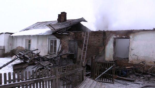 Пострадавший от пожара частный дом в Новосибирской области. 3 декабря 2017