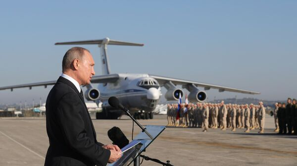 Владимир Путин во время посещения авиабазы Хмеймим в Сирии. 11 декабря 2017