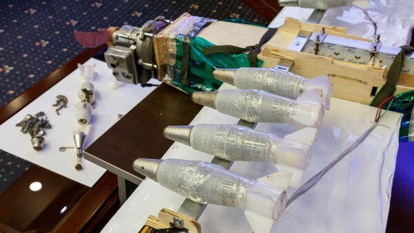 Демонстрация образцов беспилотной летательной техники во время брифинга Минобороны РФ по вопросам применения беспилотной летательной авиации в Сирии