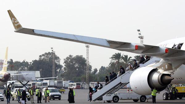 Пассажиры в аэропорту Митига в Триполи, Ливия. 20 января 2018
