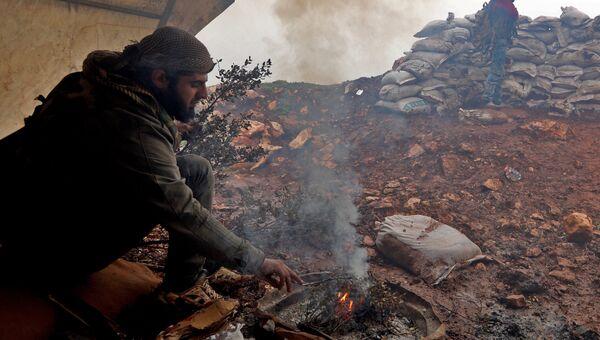 Боец Свободной Сирийской армии на юго-западном краю региона Африн. 24 января 2018