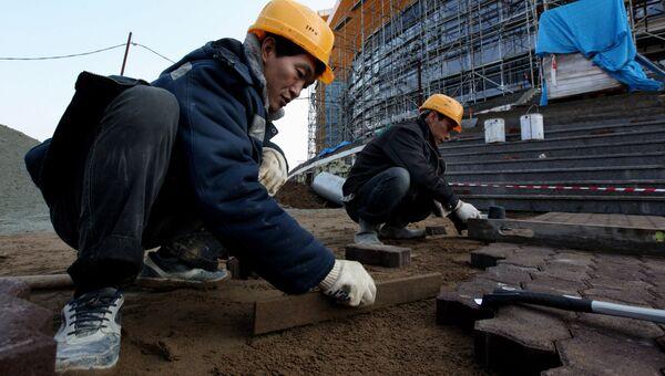 Рабочие из КНДР на строительстве в России. Архивное фото