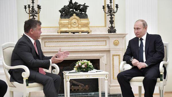 Президент РФ Владимир Путин и король Иордании Абдалла II бен аль Хусейн во время встречи. 15 февраля 2018