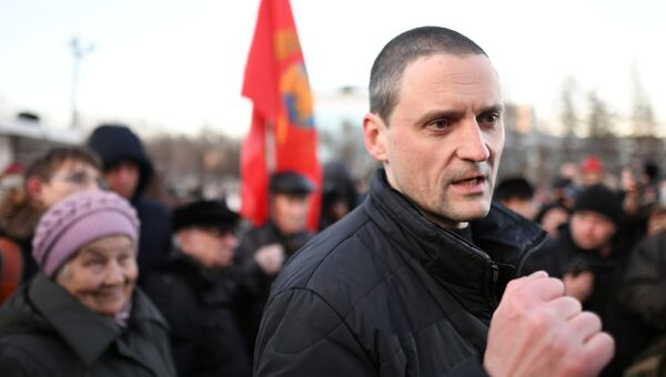Лидер движения Авангард красной молодёжи, координатор движения Левый фронт Сергей Удальцов на митинге оппозиции в Москве по итогам президентских выборов. 19 марта 2018