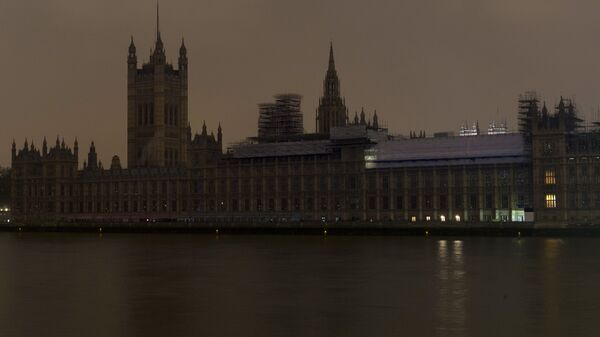 Вестминстерский дворец после отключения подсветки в рамках экологической акции Час Земли в Лондоне