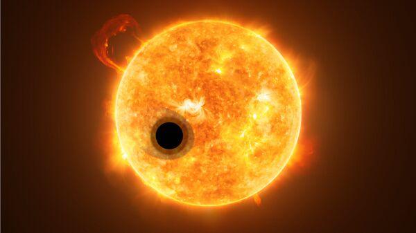 Планета WASP-107b на фоне материнской звезды