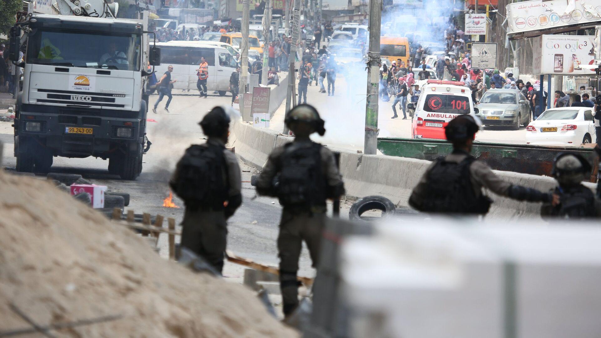 Уличные протесты в Палестине против переноса посольства США в Иерусалим. 14 мая 2018 - РИА Новости, 1920, 06.02.2020