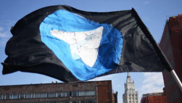 Флаг с логотипом мессенджера Telegram