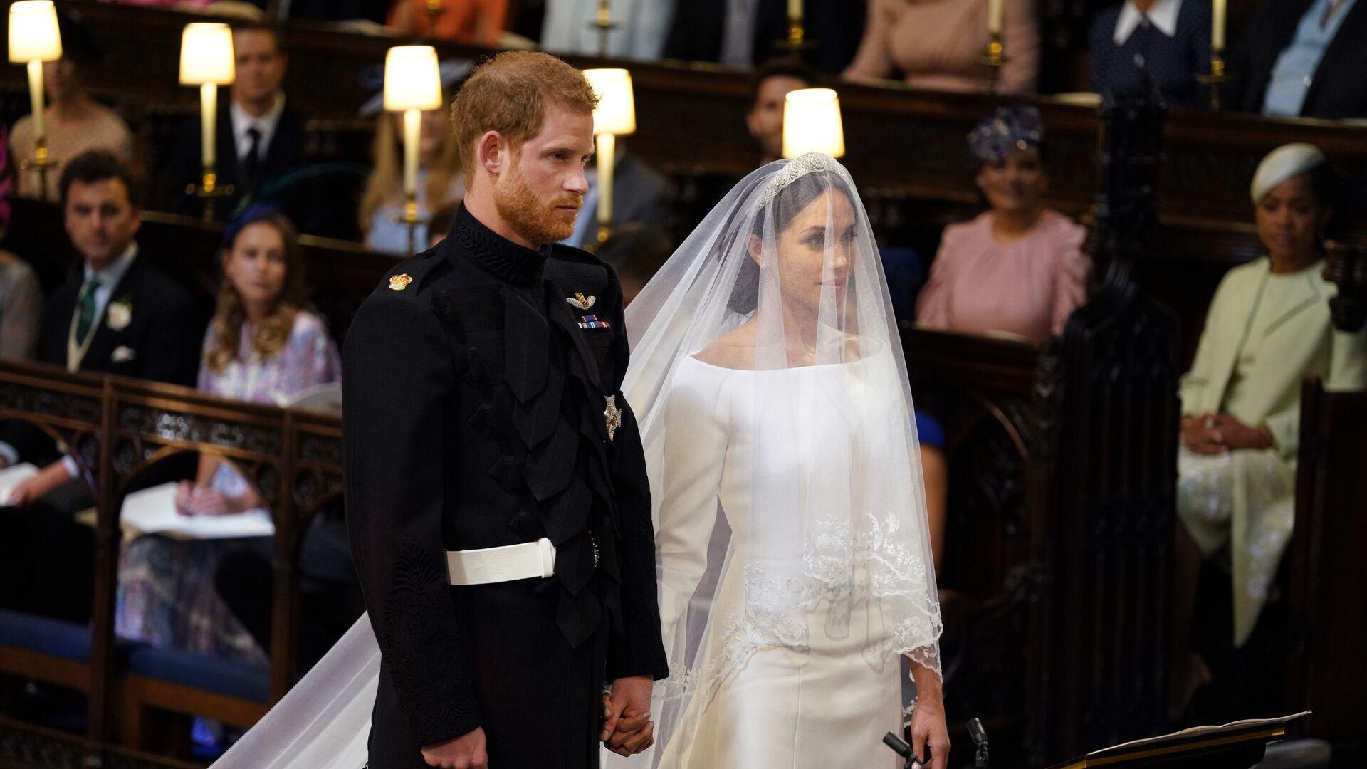 Британский принц Гарри и Меган Маркл перед началом их свадебной церемонии в часовне Св. Георгия в Виндзорском замке недалеко от Лондона, Англия. 19 мая 2018 - РИА Новости, 1920, 04.09.2020