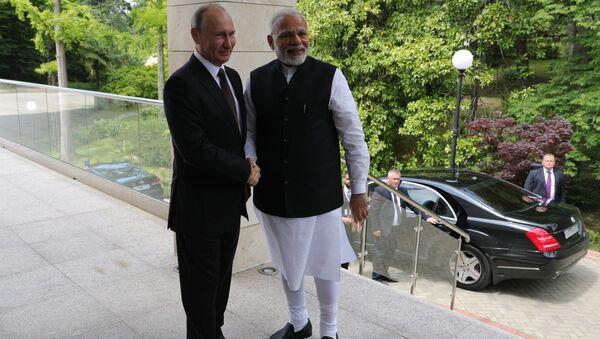 21 мая 2018. Президент РФ Владимир Путин и премьер-министр Республики Индии Нарендра Моди (справа) во время встречи. Архивное фото