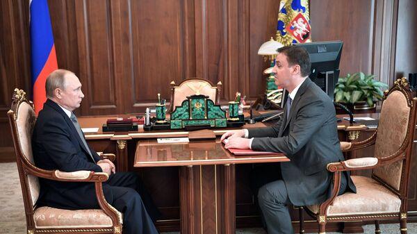 Владимир Путин и министр сельского хозяйства Дмитрий Патрушев во время встречи